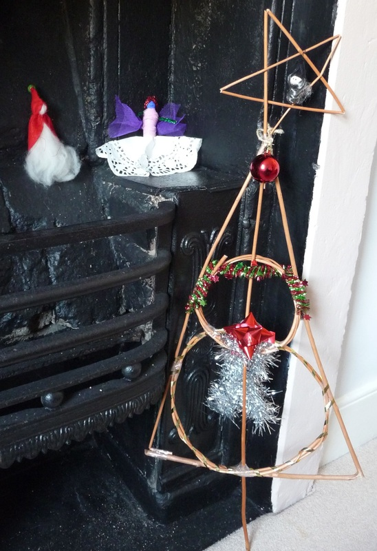 Christmas decorations: a gnome, an angel and a willow tree