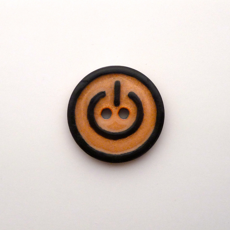 Power Button: an enamel button made for The Button Project