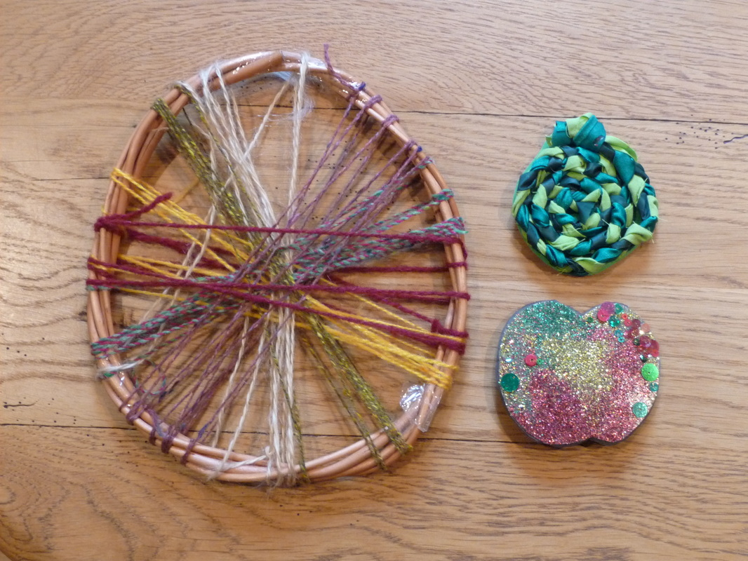Apple crafts using wool, willow, ribbon and glitter
