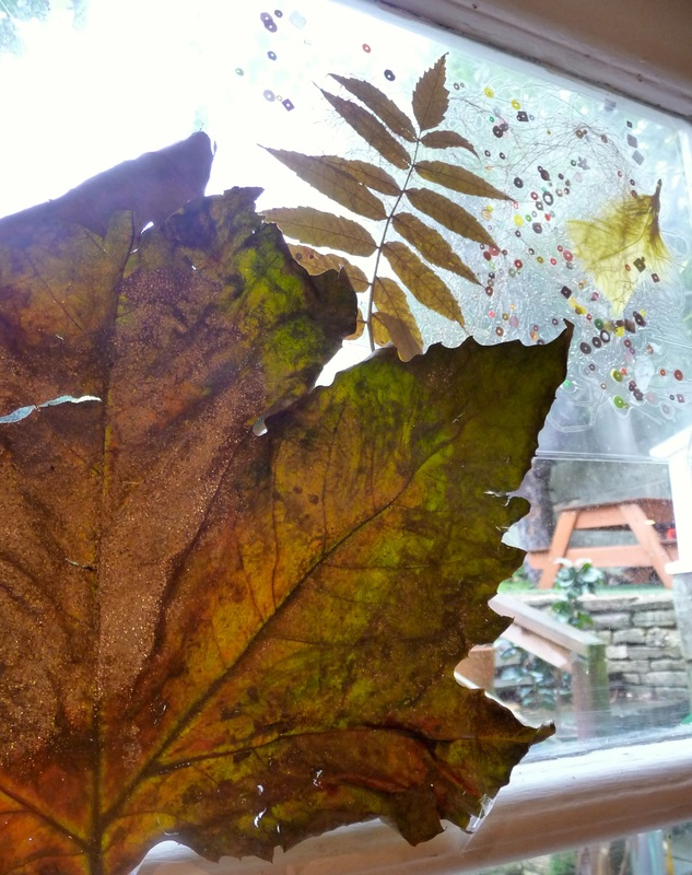 Autumn collage and painted leaf