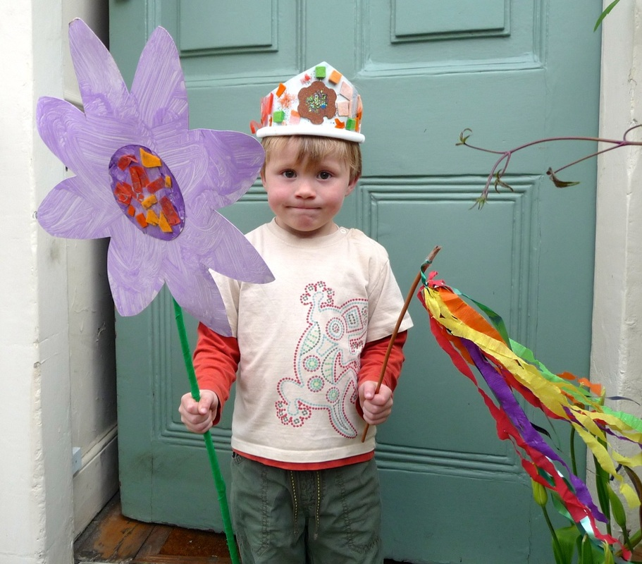 May Day crafts: crown, streamer stick and giant flower
