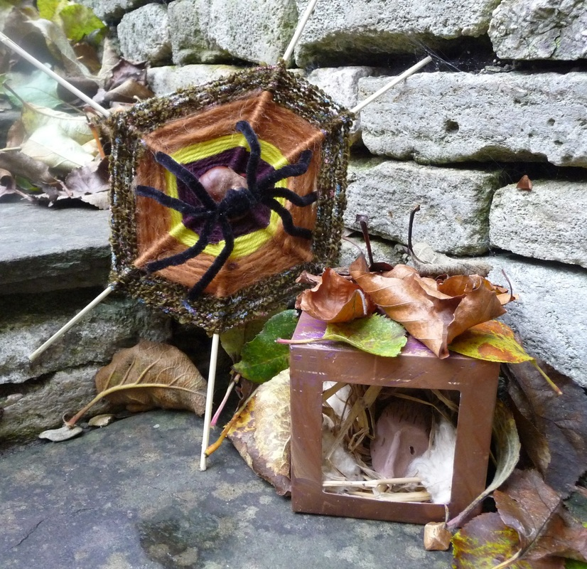 Pipe cleaner spider with woolly web; clay hedgehog in painted box